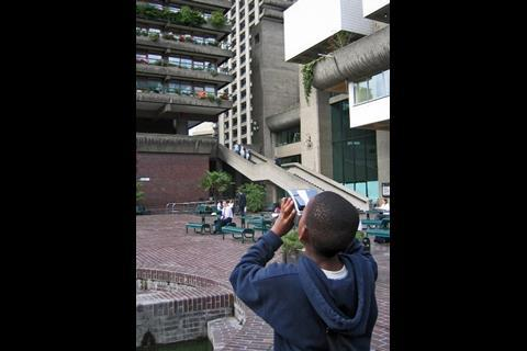 Youngster photographing building